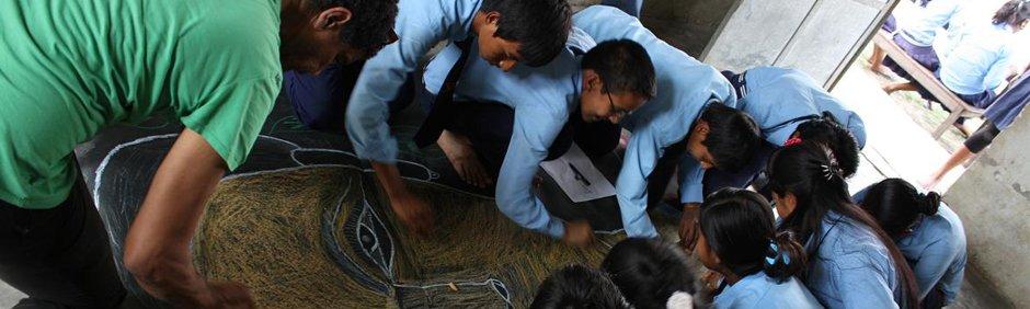 smARTpower artist Pepón Osorio collaborating with children in Chitwan, Nepal.