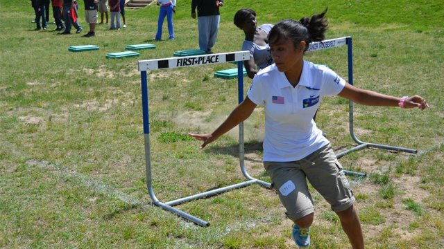 The sports visitors learn new track and field techniques and exercises at a clinic in Washington.