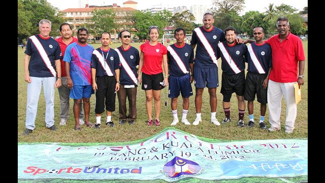 Tony Sanneh, Danielle Slaton and Ambassador Jones join Malaysian soccer coaches after a day of sessions and training clinics.