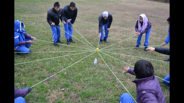 The delegation works together during a teambuilding exercise.