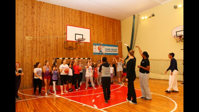Sports Envoys Tamika Raymond and Nykesha Sales work with NBA representative Becky Bonner to lead an exercise focused exclusively on three-pointers.