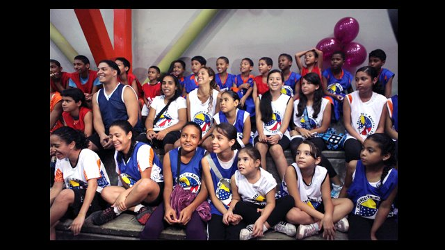 Clinic participants watch the activities in the gymnasium in Chacao, Venezuela.