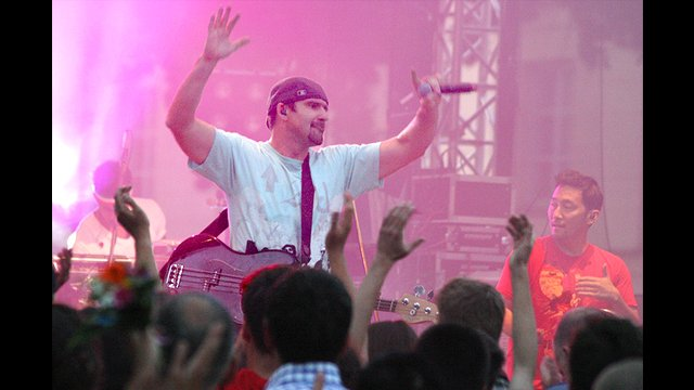 Ozomatli band member Willy Abers energizes the audience in Warsaw, Poland.