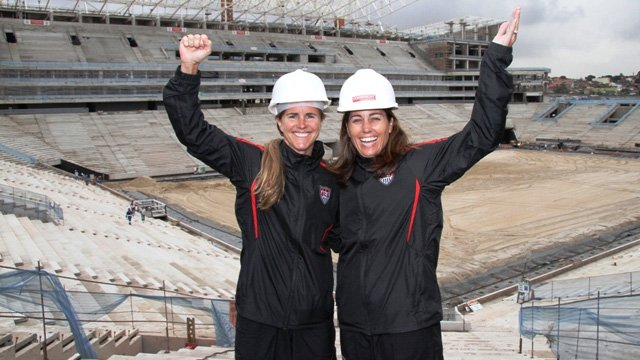 In the build up to the 2014 FIFA World Cup, Brazil still has a lot of work to do. Sports envoys Foudy and Chastain visit a soccer stadium under construction.