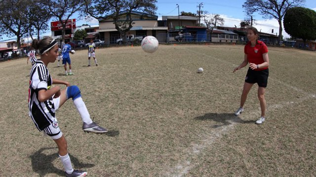 Tracy helps a teenage Costa Rican girl perfect her shin-kick.