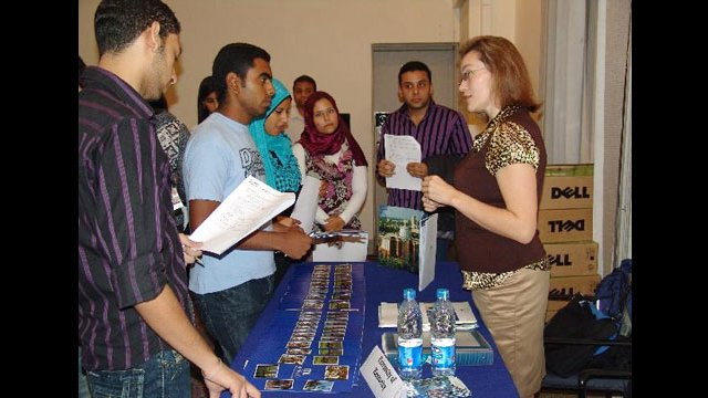 Advisers and students at a College Fair in Egypt.