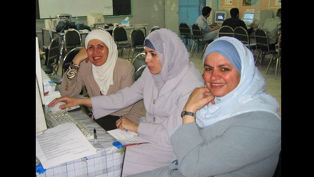 Teachers in Jordan collaborate during an English language workshop.