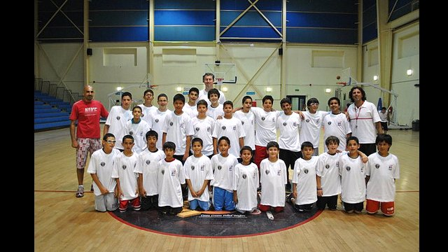 Marty Conlon poses with a group of young athletes in Jordan.