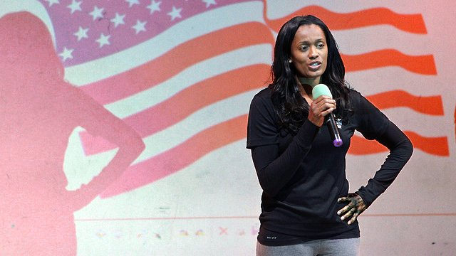 Current WNBA Player and USA 2012 Women's Olympic Basketball Team Player Swin Cash speaks to a group of students in London.
