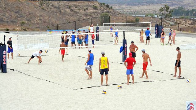 Groups of young athletes work out on the training courts.