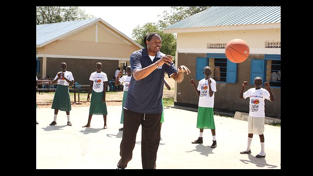 NBA Legend Sam Perkins leads the girls in a passing drill.