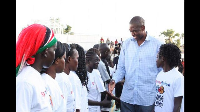 Sports Envoy Dikembe Mutombo meets with the girls basketball team.