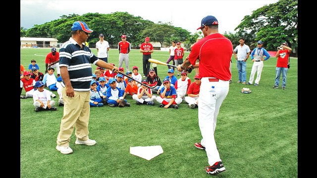 Barry Larkin works on batting with an Ecuadorian coach and his team at Yeyo Uraga, a sports complex in Guayaquil.
