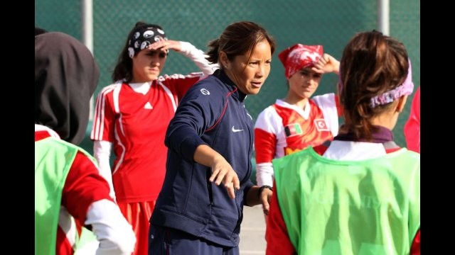Sports Envoy Lorrie Fair gives tips on soccer techniques.