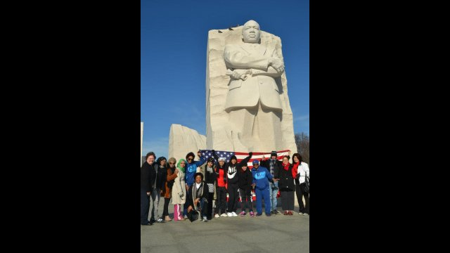 The delegation of coaches from Bahrain, Oman, Qatar, and Yemen group together in front of the Martin Luther King, Jr. monument in Washington, D.C.