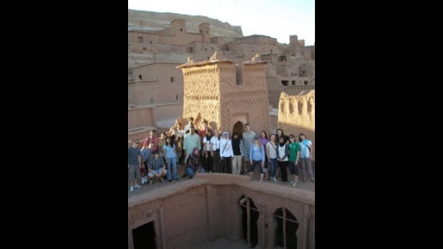 NSLI-Y scholars pose in front of a tower at Aït Benhaddou.