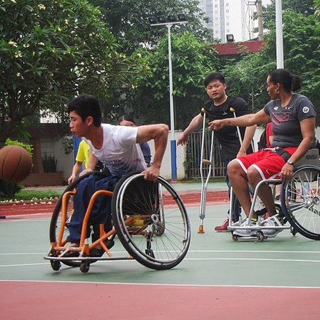 photo of sports envoys playing basketball