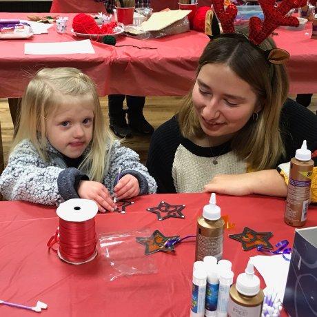 Paulina Hess volunteering with child