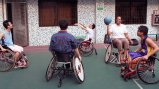 Dr. Woodson-Smith plays wheelchair basketball with some of the students at Guangzhou English Training Center (GETCH).