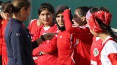 """Sports Envoy Lorrie Fair gives a """"pep talk"""" to members of the Afghan Women's National Soccer Team."""