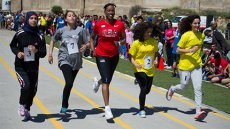 Jackie takes a jog and connects with young women on an individual basis