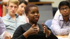 Isa Mdingi speaking in class