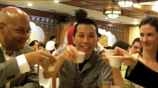 """""""Citizen Diplomats"""" from the National Council for International Visitors raise their tea cups in a gesture meant to welcome visitors from around the world."""