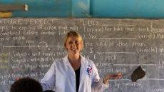 Teacher standing in front of class near chalkboard