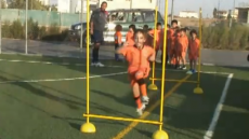 Cypriot children run drills to improve strength and agility during soccer practice