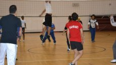 The female volleyball coaches take part in a friendly game with Americans.
