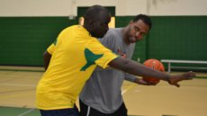 One of the participants shares tips on shooting with a D.C.-area coaching peer.