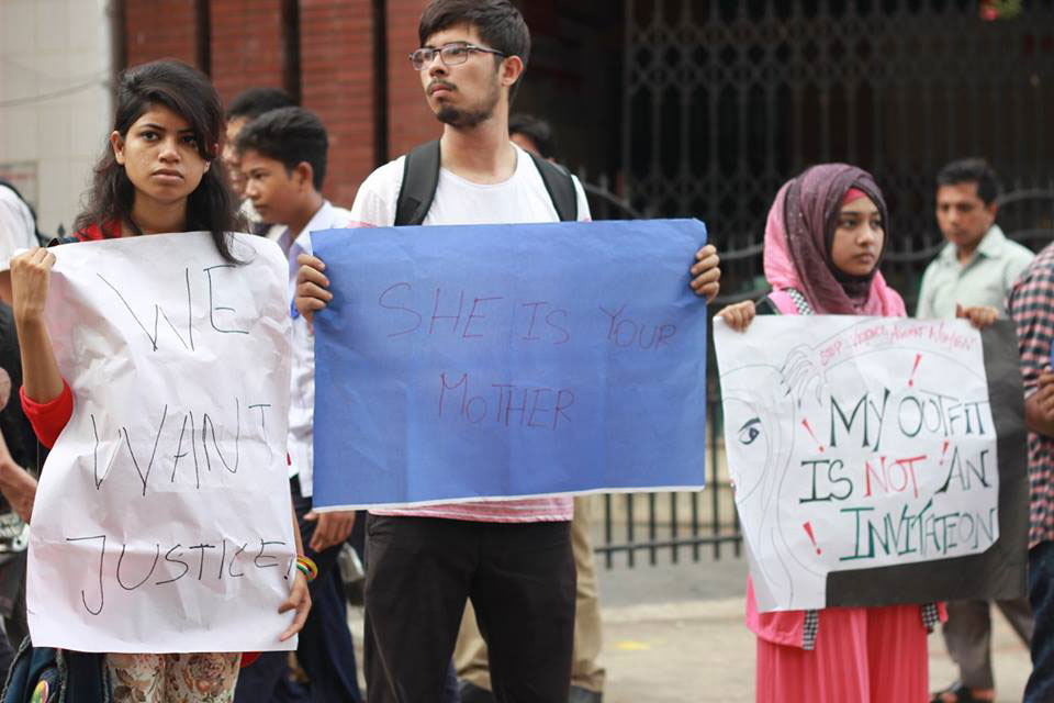 Three young people holding signs in what appears to be a protest