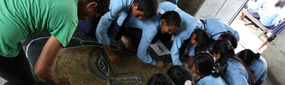 smARTpower artist Pepón Osorio collaborating with children in Chitwan, Nepal.