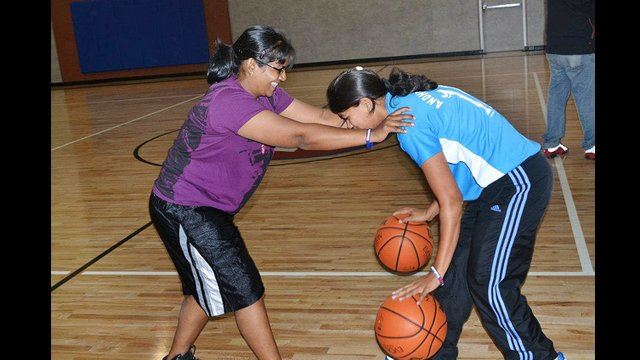 Indian basketball coaches work on dribbling and balance skills in Washington, D.C.