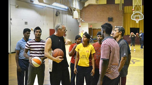 """Buzz """"Shot Doctor"""" Braman led an intensive basketball clinic in Washington, D.C. for the Indian visitors."""