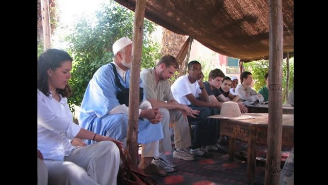 NSLI-Y scholars rest under a tent and prepare for tea
